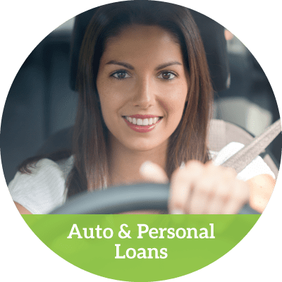 a smiling young woman behind the wheel of a car (auto and personal loans button)
