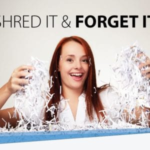 "crazed woman grabbing shredded paper with tagline ""shred it and forget it"""