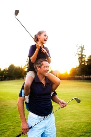 Dad and daughter golfing